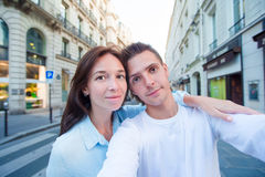 Happy young couple taking selfie in Paris outdoors Royalty Free Stock Photo