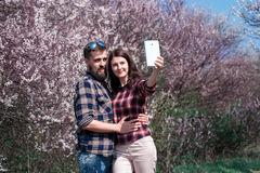Happy young couple taking selfie in the park03 Royalty Free Stock Images