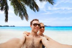 Happy young couple taking selfie photo on the beach royalty free stock photo