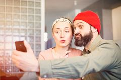 Happy young couple taking selfie photo at home. Romantic relationship between people. Happy young couple taking selfie photo at home. Romantic relationship royalty free stock image