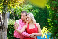 Happy young couple taking a selfie with smart phone royalty free stock photography
