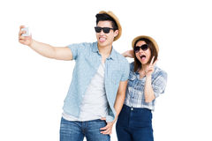 Happy young couple taking a selfie Stock Image