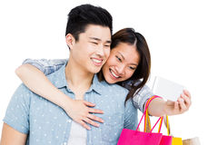Happy young couple taking a selfie Royalty Free Stock Image