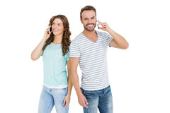Happy young couple talking on mobile phone Royalty Free Stock Images
