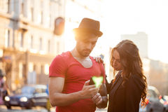 Happy young couple texting Royalty Free Stock Image