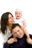 Happy young couple with their baby daughter. Stock Photography