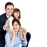 Happy young couple with their daughter royalty free stock photo