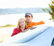 Happy young couple with their new car Royalty Free Stock Images