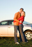 Happy young couple with their new car Stock Image