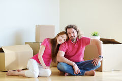 Happy young couple in their new home Stock Photos