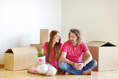Happy young couple in their new home Stock Image
