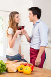 Happy Young Couple Toasting Wine Glass Royalty Free Stock Images