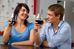 Happy young couple toasting wine together Stock Image