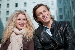 Happy young couple together. Happy smiling young couple together outside portrait Stock Images