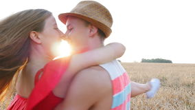 Happy young couple together in countryside having fun stock footage