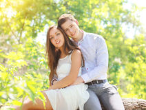 Happy young couple together in sunny summer. Day Stock Photography