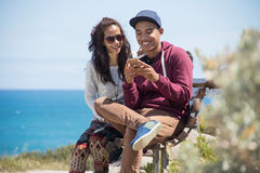 Happy young couple together using mobile phone royalty free stock photos