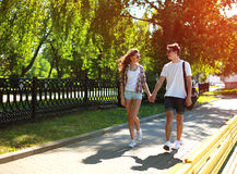Happy young couple together walking in summer park Royalty Free Stock Images
