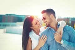 Happy young couple toothy smiling each other and embracing outdo royalty free stock images