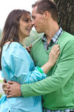 Happy young couple by tree Royalty Free Stock Photos
