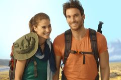 Happy young couple trekking Royalty Free Stock Image