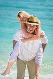 Happy young couple on tropical beach Stock Photos
