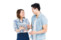 Happy young couple using digital tablet Royalty Free Stock Photos