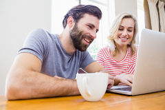 Happy young couple using laptop Stock Image