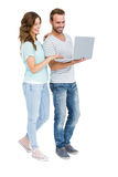 Happy young couple using laptop. On white background Stock Photos