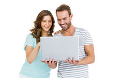Happy young couple using laptop. On white background Royalty Free Stock Image