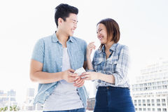 Happy young couple using mobile phone Royalty Free Stock Photo