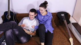 Happy Young Couple using Tablet PC on the couch stock video footage