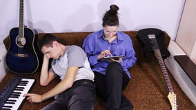 Happy Young Couple using Tablet PC and play piano stock video