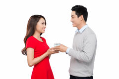 Happy young couple with Valentine's Day present Stock Photography