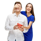 Happy young couple with Valentine`s Day present Stock Photography