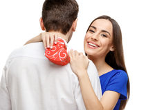 Happy young couple with Valentine`s Day present Royalty Free Stock Photos