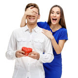 Happy young couple with Valentine`s Day present Stock Image