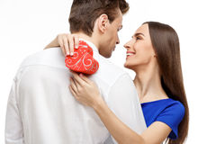 Happy young couple with Valentine`s Day present Royalty Free Stock Image