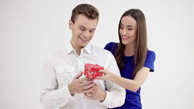 Happy young couple with Valentine`s Day present. Valentine gift. Happy young couple with Valentine`s Day present isolated on a white background stock footage
