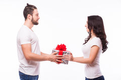 Happy young couple with Valentine's Day present isolated on a white background. Stock Image