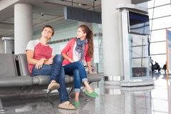 Happy young couple waiting for boarding at airport Royalty Free Stock Photos