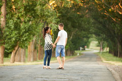 Happy young couple walk on country road outdoor, romantic people concept, summer season Stock Photography