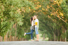 Happy young couple walk on country road outdoor, romantic people concept, summer season Stock Images