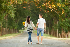 Happy young couple walk on country road outdoor, romantic people concept, summer season Royalty Free Stock Photography