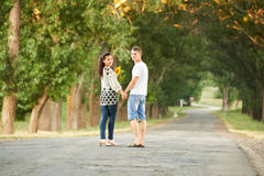 Happy young couple walk on country road outdoor, romantic people concept, summer season Royalty Free Stock Photo