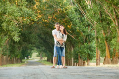 Happy young couple walk on country road outdoor, romantic people concept, summer season Stock Photo