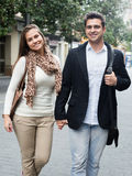 Happy young couple walking at autumn day Stock Image