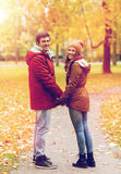 Happy young couple walking in autumn park Stock Images