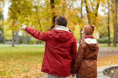 Happy young couple walking in autumn park Royalty Free Stock Photography