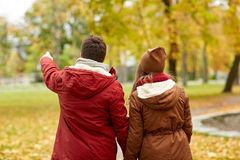 Happy young couple walking in autumn park Stock Photos